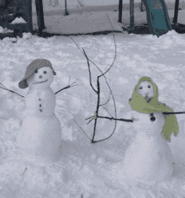 girl and boy snowman