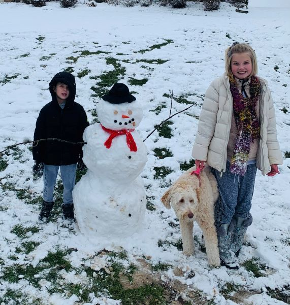 Snowman with a boy and girl and a dog