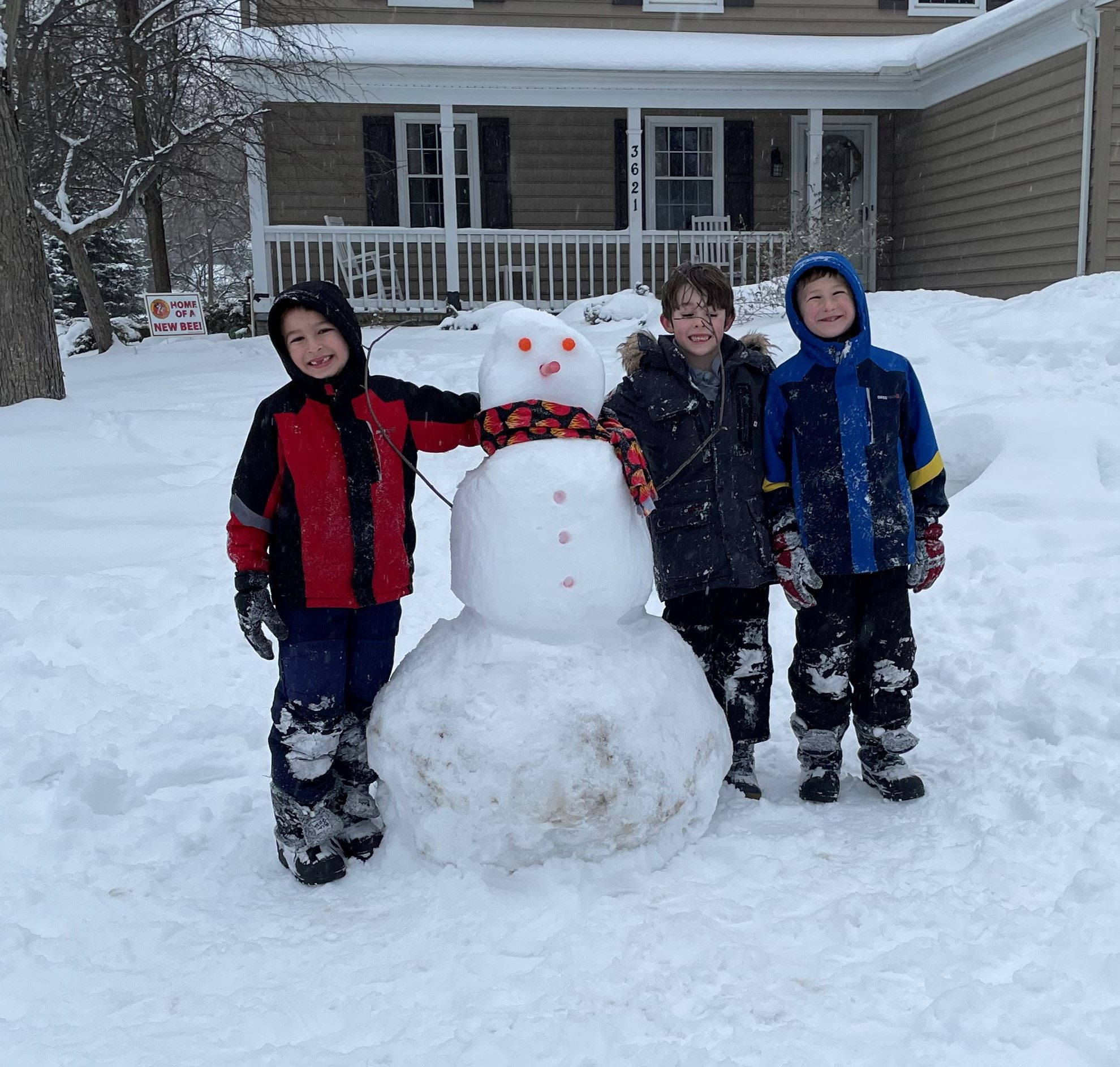 Snowman with three boys