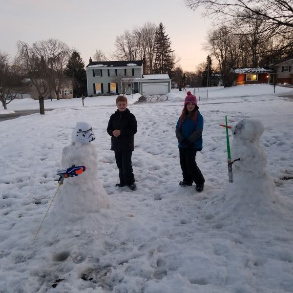 snowman that looks like Luke Skywalker & snowman that looks like Stormtrooper