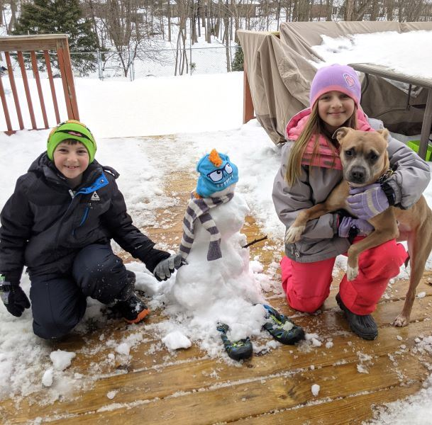 A monster snowman with two children