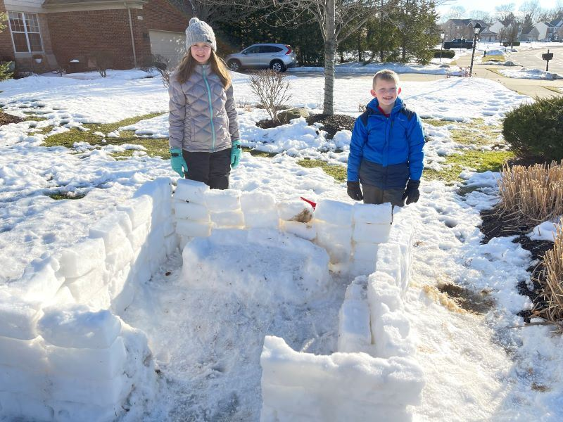 House made of snow bricks with two children